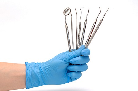 Dentist holding Dentistry tools